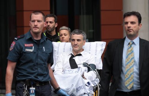 Banking royal commission witness leaves hearing in stretcher.